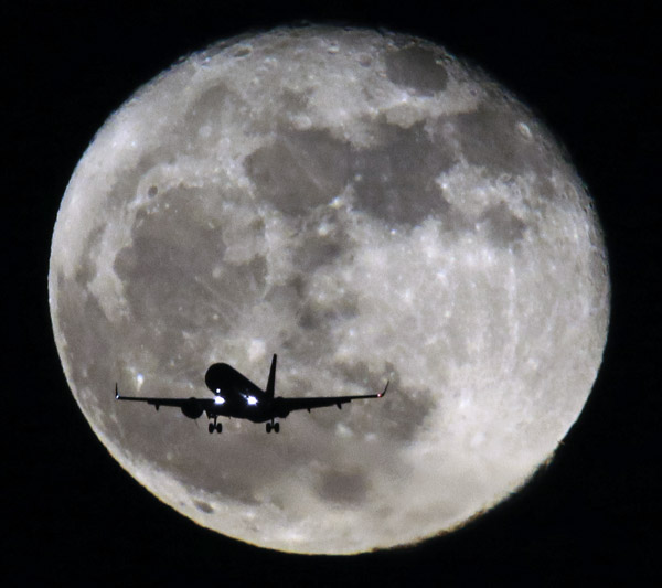 December 19, 2013. A cold moon greets an incoming airliner as seen from Winthrop.