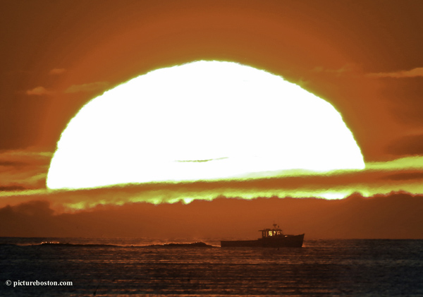 Sunrise with Boston Harbor fishermen.