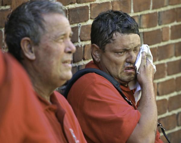 08/07/2015-Boston,MA. Boston firefighters take a break from fighting a 3 alarm fire at 6 Waverly St. in Roxbury today. Staff photo by Mark Garfinkel