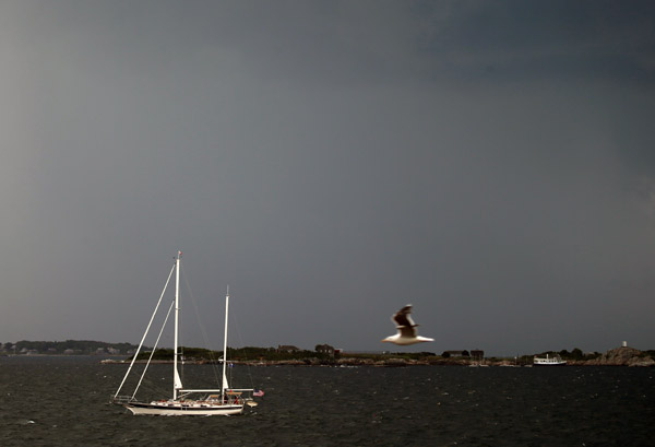 A sailboat escapes the Marblehead lightning, choosing to come into port shortly after the storm.