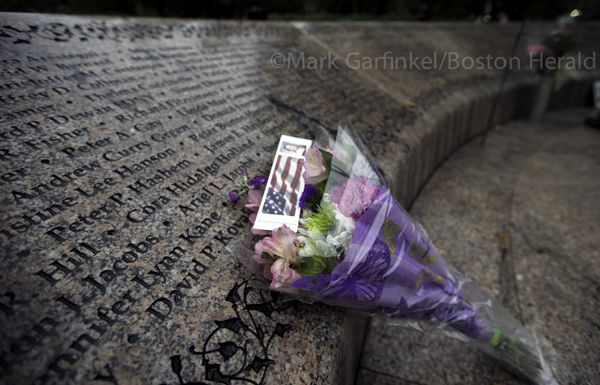 09/11/2015-Boston,MA. Flowers are left at the Massachusetts 911 memorial during Friday morning's ceremony commemorating the14th anniversary of the 2001 terror attacks  . Staff Photo by Mark Garfinkel