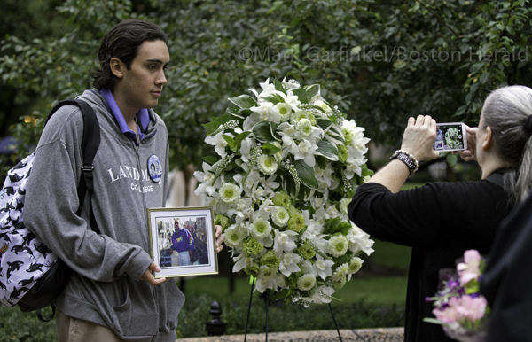 09/11/2015-Boston,MA. Marc Sanchez holds a photo of his father Jesus Sanchez, who died in the September 11 terror attacks, as his mother Lynn Greene snaps a photo at Friday morning's ceremony commemorating the14th anniversary of the 2001 terror attacks, at the Massachusetts 911 memorial. Staff Photo by Mark Garfinkel