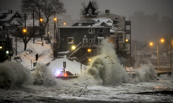 01/27/2015-Winthrop,MA. Tuesday afternoon's high tide, the 2nd in a series of damaging tides that occurred today, during the storm, splashes over the sea wall on the Revere/Winthrop town line on Revere St. Staff Photo by Mark Garfinkel