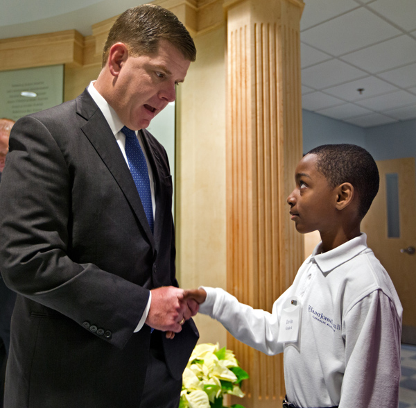 12/02/2015-Boston,MA. Mayor Martin J. Walsh is greeted by student Devin Allen, 4th grade, at the re-dedication of Saint John Paul 11 Catholic Academy Lower Mills Campus, on Dorchester Ave. Staff photo by Mark Garfinkel